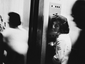 "Sharon (maiden name Goldstein), at 15-years-old, was the elevator girl at Miami's Sherry Frontenac Hotel. Robert Frank's famous image is called ""Elevator — Miami Beach, 1955."" Collection Philadelphia Museum of Art, purchased with funds contributed by Dorothy Norman, 1969. Copyright Robert Frank."
