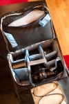 You can quickly access the main compartment through the top pouch. Very handy if you just need to grab a lens.